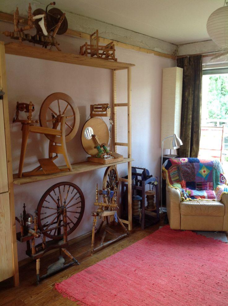 My herd of spinning wheels nicely stored on shelves