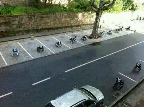 """Brilliant protest in Lisbon, Portugal. Wheelchair parked with notes on them """"be right back"""" """"just getting something"""""""