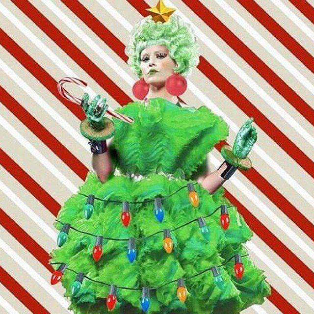 Pin for Later: Get Festive For the Holiday Season With the Cutest Celebrity Christmas Snaps of All Time!  Elizabeth Banks shared a rather festive version of Effie Trinket from The Hunger Games in 2014.