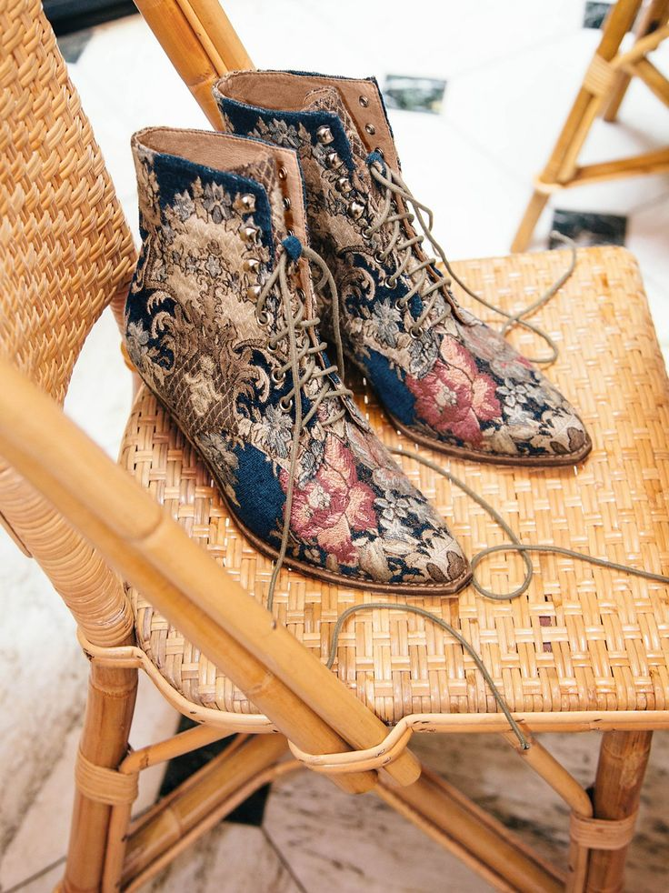 Grove Lace-Up Western Boot   In a bold design, these fabric ankle boots with lace-up detailing.    * Pointed toe   * Western-inspired stacked heel   * Metal grommets
