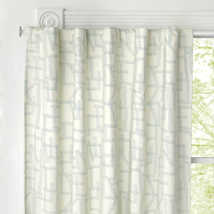 Shop 96'' Blue Blackout Curtain. Adorned with illustrations by artist Jenny Pennywood, these printed curtains have a hand-drawn design that makes them both sophisticated and playful.