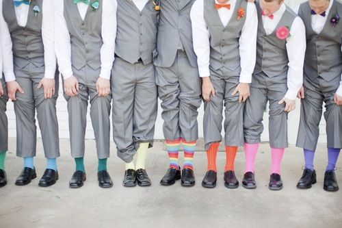 Add a subtle touch of rainbow to show your pride by coordinating with your groomsmen.