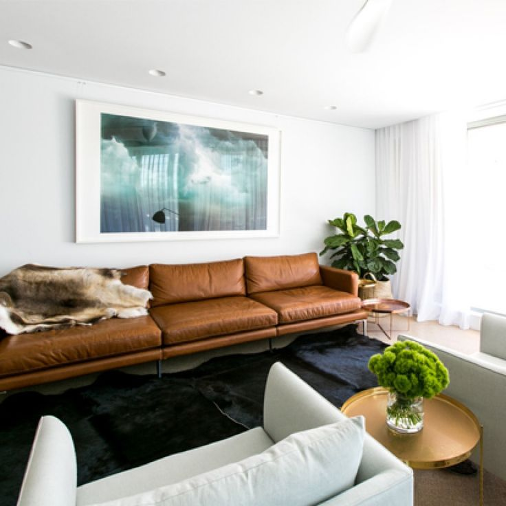 tan leather lights chairs very light gray large picture over sofa greenery home living roomliving areamodern