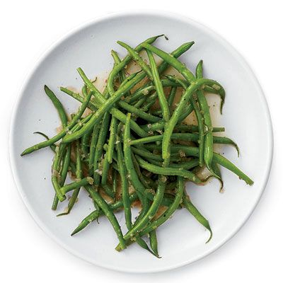 A warm dressing made with shallots, cider vinegar, and a little sugar gives fresh steamed green beans a sweet and sour flavor. Get the recipe from Delish.   - Delish.com
