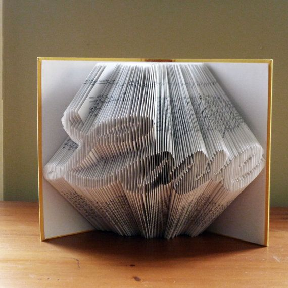 Neat book sculptures! I would like one with a treble clef or something musical!