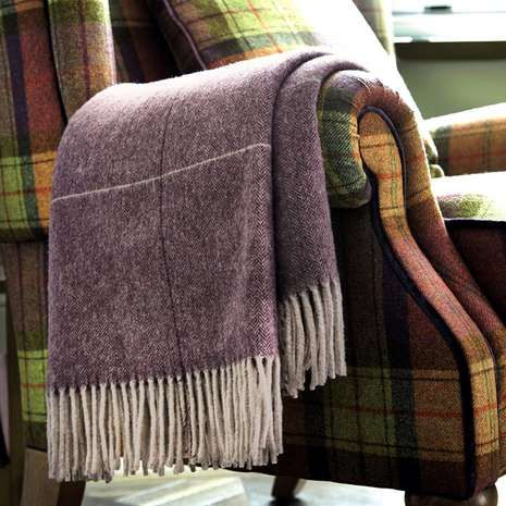 Finished with tasselled edges, this indulgent purple throw from Dorma is crafted entirely from wool and features a lightly textured effect....