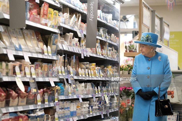 Queen Elizabeth II looks at products on the shelves at a Waitrose supermarket during a visit to the town of Poundbury on October 27, 2016 in Poundbury, Dorset. Poundbury is an experimental new town on the outskirts of Dorchester in southwest England designed with traditional urban principles championed by The Prince of Wales and built on land owned by the Duchy of Cornwall. (Photo by Justin Tallis - WPA Pool/Getty Images)