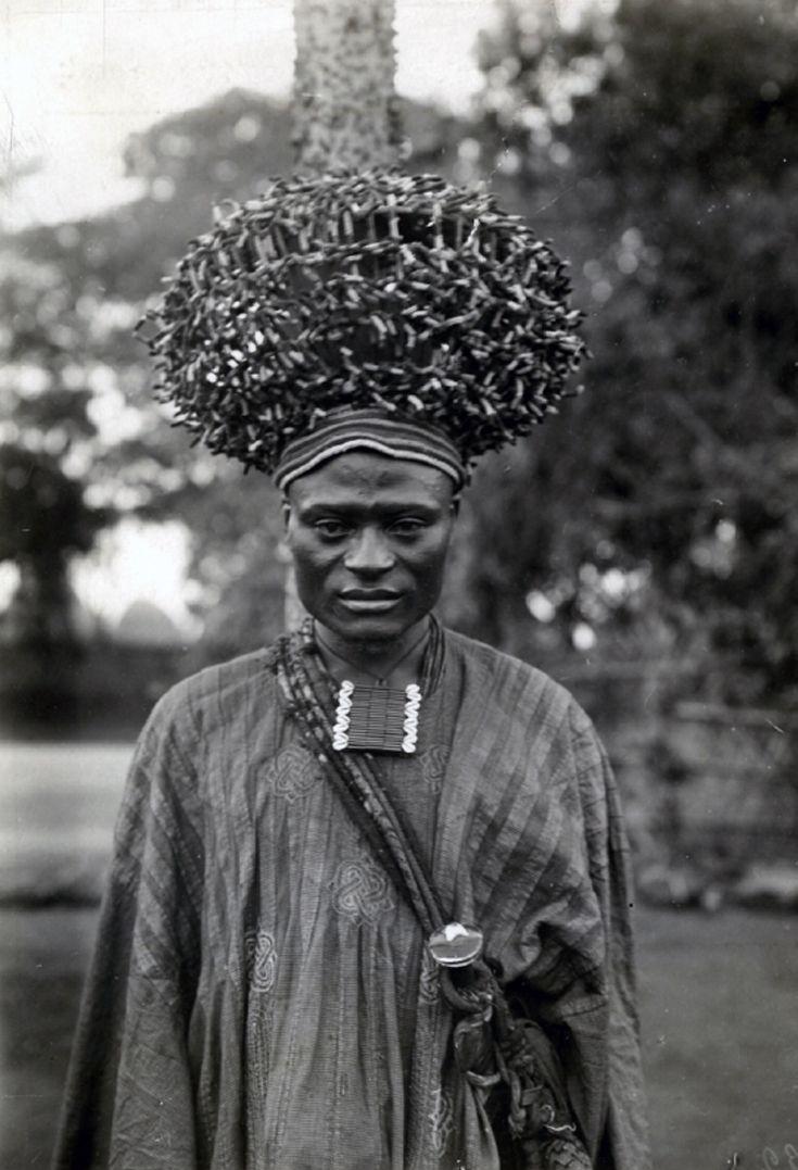 World Bedroom Furniture: Man Wearing The Headdress From Chief Nzoya's