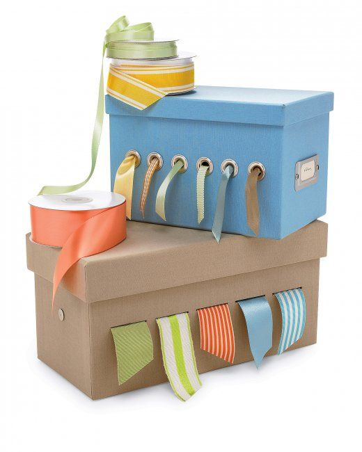 Ribbon Dispenser - punch grommet holes in cardboard box. Can also be used as a charging station.