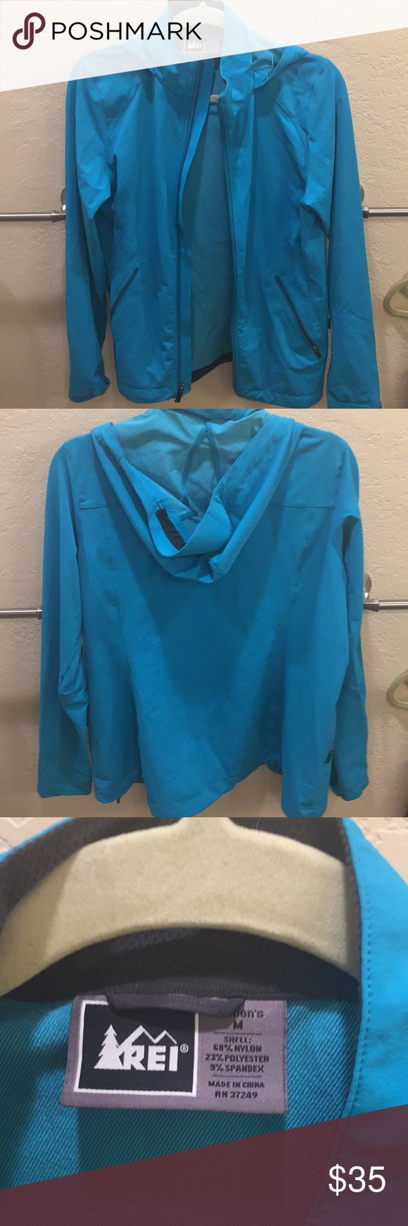 REI water resistant raincoat with hood Teal REI raincoat with hood. Perfect for hiking or every day use. Has been worn but still in good condition. It is water repellent and pretty warm. REI Jackets & Coats Utility Jackets