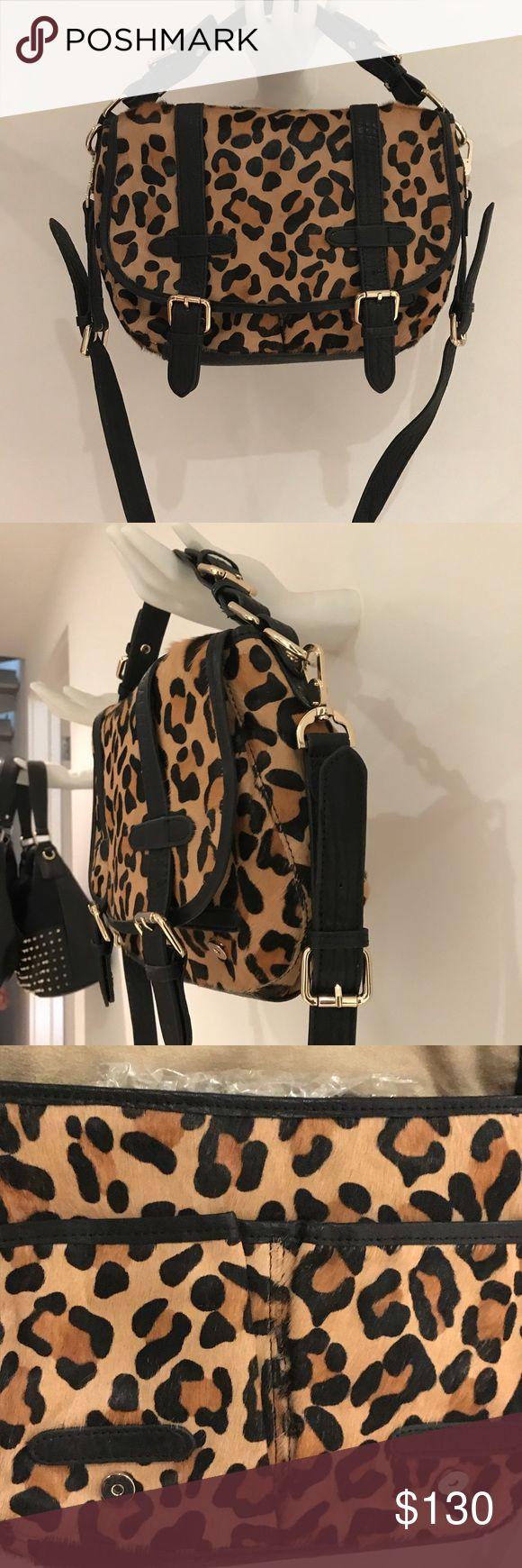 Charles David new leopard Haircalf messenger bag. New!  Beautiful Haircalf Bag. Direct from the Charles David Designer. Messenger flap. Removable shoulder strap. Charles David Bags