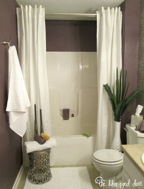 spa like bathroom remodel by using two shower curtain panels it makes the room look bigger hide one waterproof curtain behind the decorative curtain