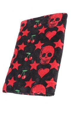 Gothic beach towel.​ This great black towel features a repeated red design made up of skulls, stars, hearts and cherries.​ This large towel is made from polyester and measures 150cm x 75cm.