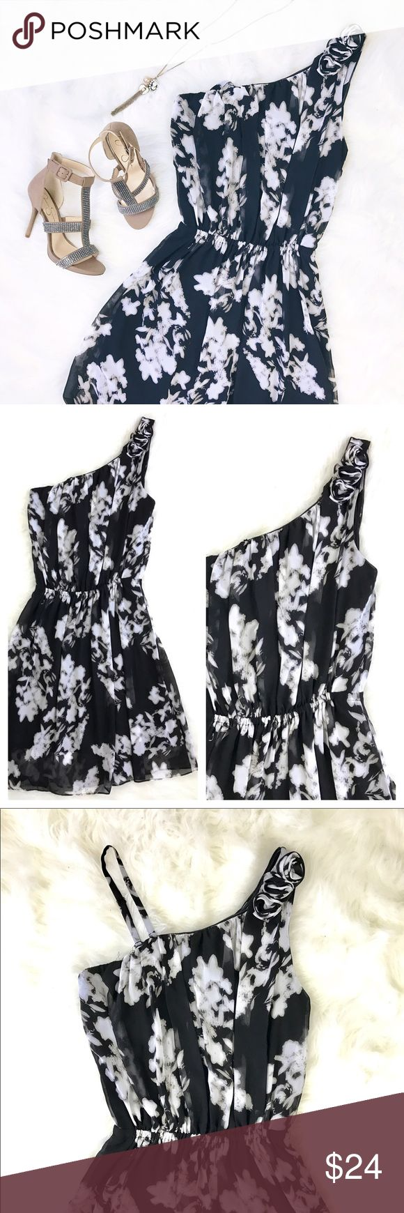 Alfani One Shoulder Floral Rosette Draped Dress Alfani Size 12 One Shoulder Black And White Floral Rosette Draped Dress  A breezy blouson fit lends relaxed elegance to this on-trend one shoulder petite floral dress from Alfani.  Polyester  Machine washable  One shoulder silhouette with rosette trim-comes with removable strap  Elastic band at waist creates blouson fit  Allover floral pattern  Pullover style with no closures  Lined  Hits slightly above knee There is a flaw near hem as…