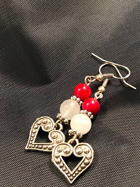One of my Moms best friend Debbie inspired these earrings. She is always wearing silver! She is so country bumpkin and I love it! Everytime I see a heart like this it reminds me of her, and the red reminds me of her big red barn! Your earrings will be shipped to you in a white