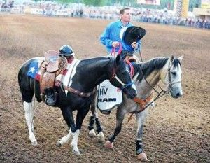 Miles-Dewitt-and-riderless-horse-for-fallen-firefighters-at-Prescott-Rodeo-This year marks the one-year anniversary of the Yarnell Hill Fire, where 19 hotshots from the Granite Mountain Hotshots died in the line of duty in northern Arizona.