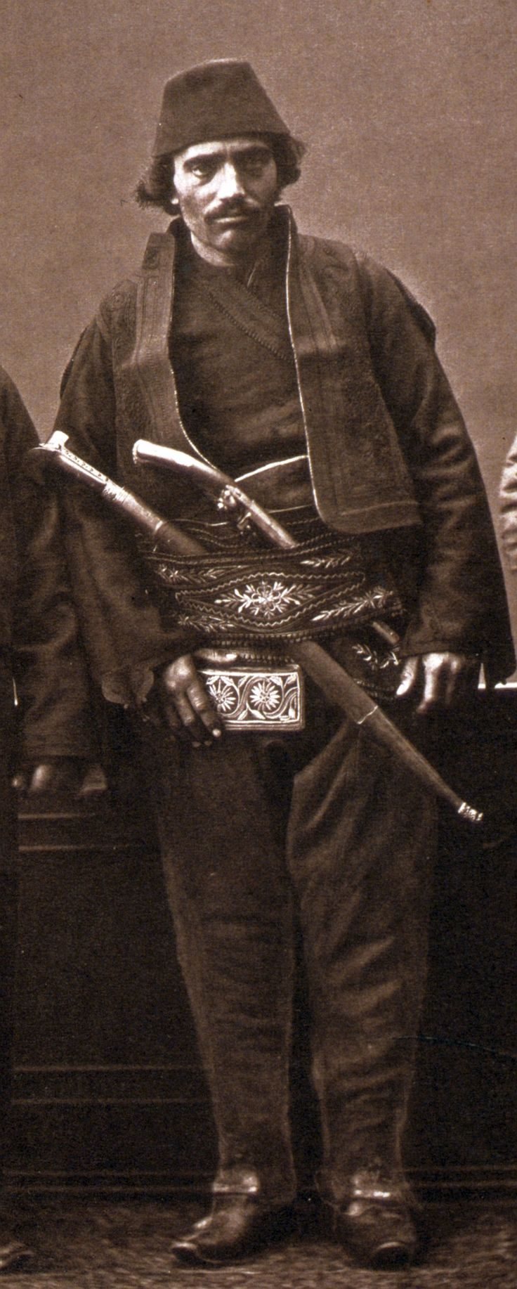 """Ottoman Muslim horseman of Andrinople (Edirne), his weapons belt (silahlik) holds a yatagan and a pistol (kuber). From:Les costumes populaires de la Turquie en 1873, 74 photographic plates by Pascal Sebah, published by the Imperial Ottoman Commission for the """"Exposition Universelle"""" of Vienna in 1873."""