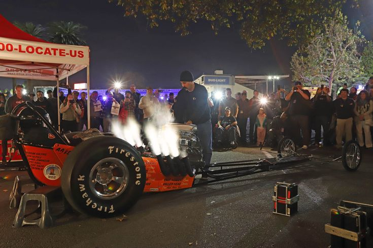 "Cackle Cackle: Outside Building No. 4, Visitors Enjoyed The Sound Of A Supercharged Hemi Engine During Five ""John Ewald Nitro Fire Ups"" In Memory Of Longtime Drag Racer And Top Fuel Dragster Owner John Ewald. As You Might Expect, The Nightly Shows Brought A Lot Of Smiles From The Public."