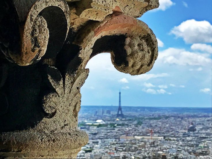 Perspective is all it takes to scale down the 300-meter-tall Eiffel Tower to a miniature version of itself compared tothe head of this old pillar; clicked from the dome of Sacré-Cœur Basilica inM…