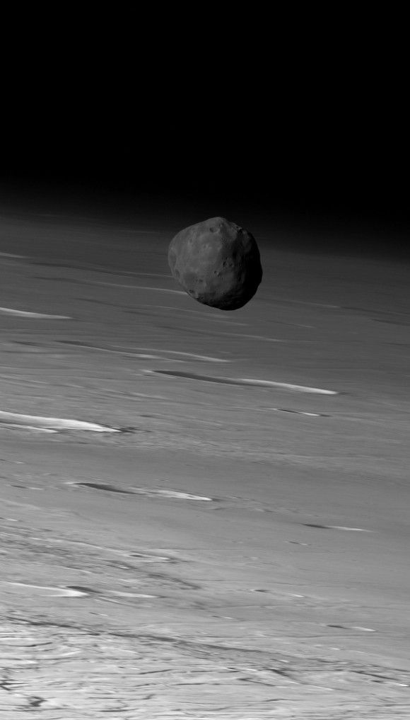 Don't miss this photo of Phobos By Deborah Byrd The larger of Mars' two moons, Phobos, orbiting in front of Mars.  Image via Mars Express / ESA / DLR / FU Berlin (G. Neukum).