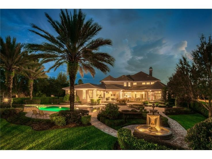 This Tampa, FL home is stunning during the day, but positively glows at night!