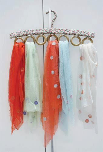 Use old shower curtain hangers....decorate them and stick them to a hanger...hang your scarves!