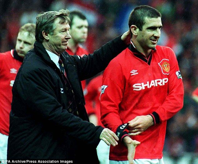 Sir Alex Ferguson celebrates with perhpas his greatest ever signing, Eric Cantona, after a victory