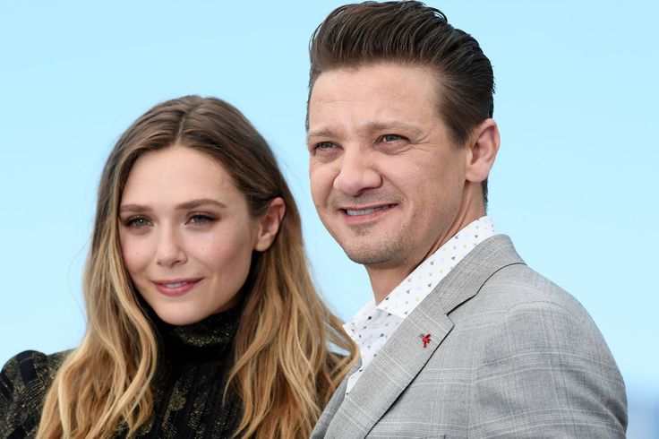 "Jeremy Renner Photos Photos - (L-R) Actors Elizabeth Olsen and Jeremy Renner attend the ""Wind River"" photocall during the 70th annual Cannes Film Festival at Palais des Festivals on May 20, 2017 in Cannes, France. - 'Wind River' Photocall - The 70th Annual Cannes Film Festival"