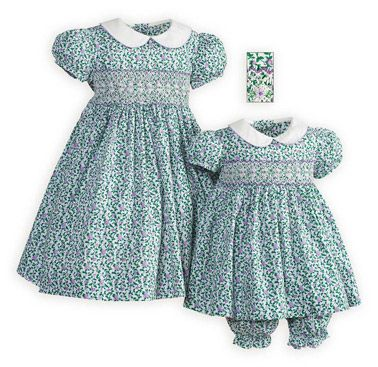 Purple Posies Hand-Smocked Sister Dresses Green vines with purple flowers splashed against a white background create the perfect summer dress. Exquisite hand smocked bodice. High-waist cotton dress has white split piqué collar piped in lilac.
