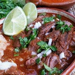 "Birria Recipe | ""A blend of chiles and spices simmered with beef stew meat. Very delicious and served with cilantro, limes, and onion as condiments and Mexican rice or beans as side dishes."""
