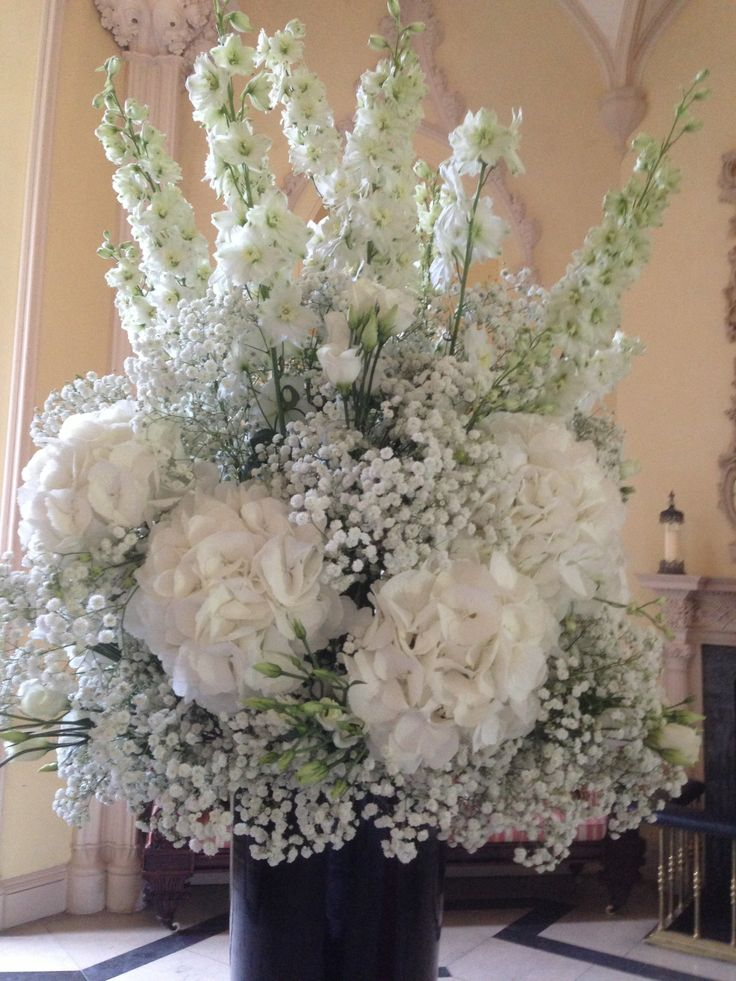 A beautiful and unique arrangement of Delphiniums, Hydrangea and Gypsophila
