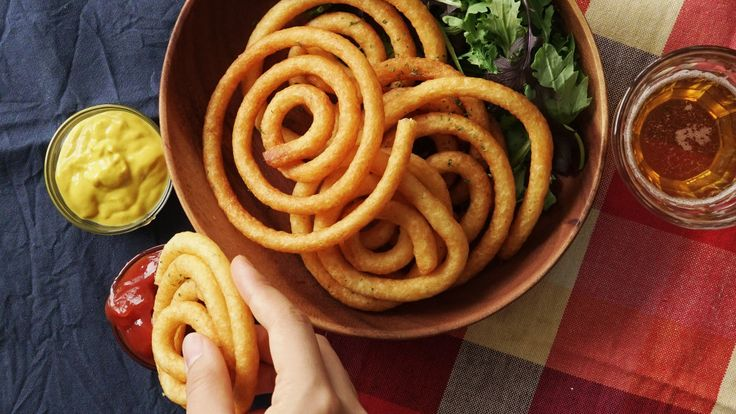 Recipe with video instructions: These crispy potatoes are like epic curly fries. Ingredients: 350g potato, peeled, 1 egg, beaten, 10g potato starch, salt, pepper, 10g parmesan cheese, 50g milk