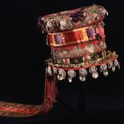 In Tinn, Norway, A Telemark hat is the most prominent part of the bridal dress. It has the shape of a top hat is adorned with silk ribbons and sølvkniplinger. Brooches and other costume silver is sewn o
