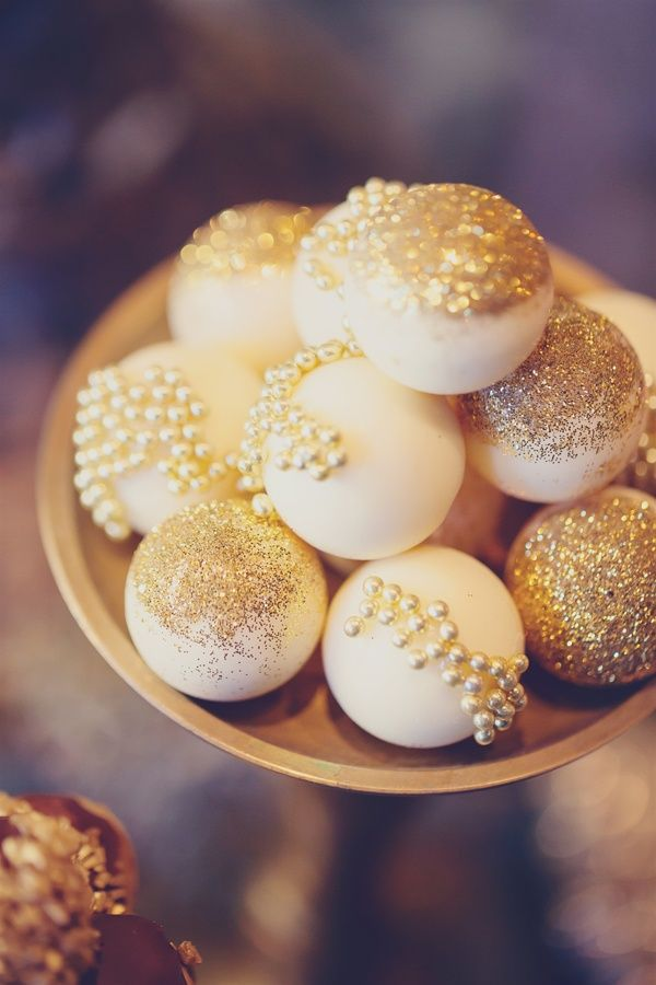 Decadent and luxurious gold and white cake pops for dessert or as wedding favors