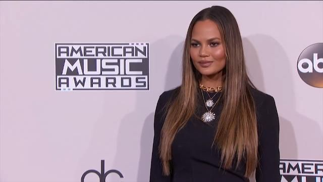 Chrissy Teigen apologises for flashing her 'hoo-ha' at the American Music Awards.
