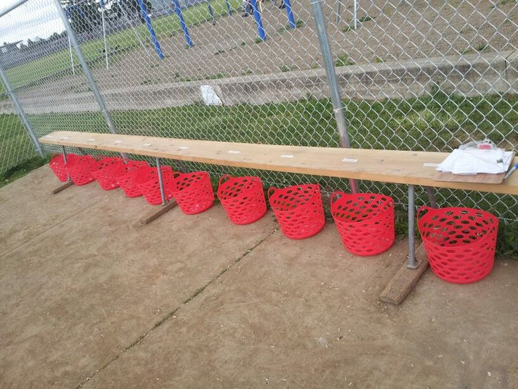 This has been great for coaching tball...put strips of tape on the bench with each players name ..then the red baskets underneath for each kids helmuts,mits,hats & waterbottles..