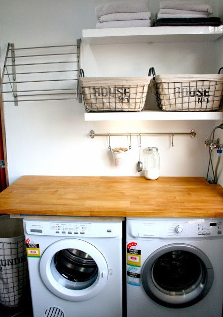 Laundry area. Drying rack from Ikea. Fintorp rail also from Ikea to hold misc. laundry stuff.