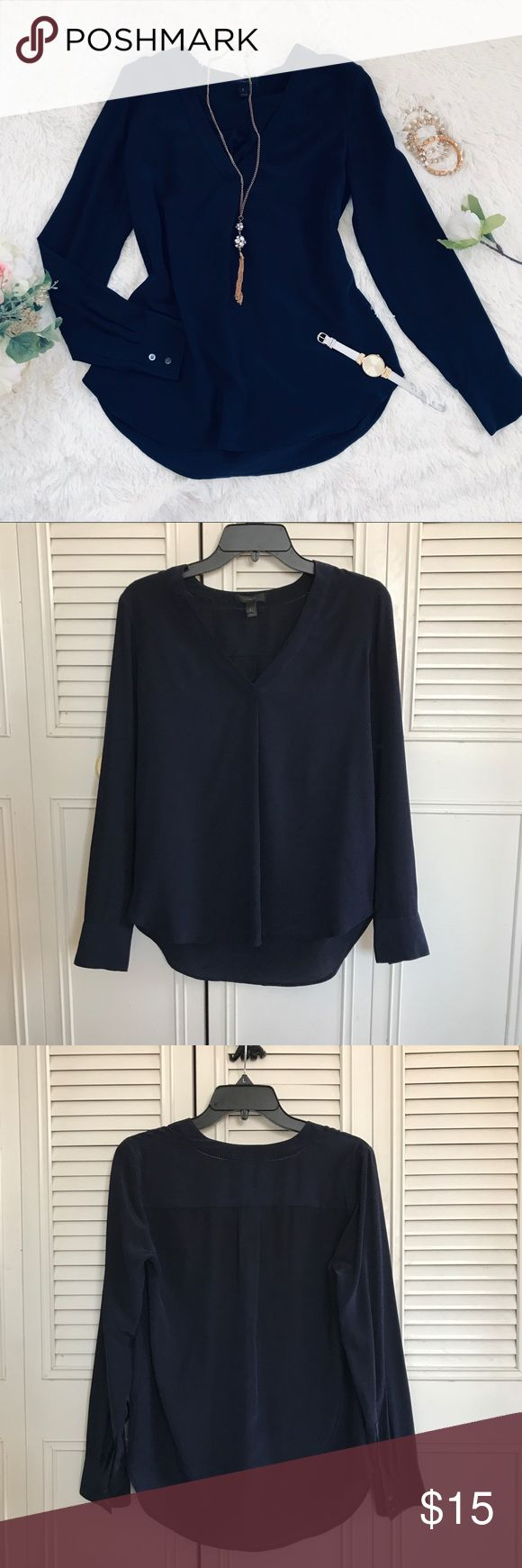 J. Crew Women's Navy Long sleeve top This women's long sleeve top is come in a dark blue navy color. It feature V-neck, plain and simple top. Worn once, still in good condition.   Material: See last picture of material.   Best offer accept. J. Crew Tops Blouses