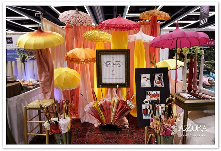 Love the idea of the umbrellas.  Booth Display