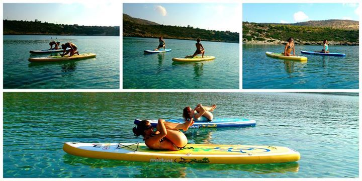 Enjoying an early morning SUP Yoga class with Nefeli Stamouli at the crystal clear waters of Loutraki beach, Chania Crete on our Mistral boards.  http://paddleboardyoga.net/