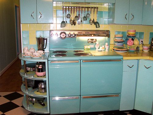 Awesome mixed-color retro kitchen in a 1950s North Carolina home, featured on retrorenovation.com.  Vintage metal cabinets, kitchen center, and fridge!  I am in love.  This could be a dream kitchen if the cabinets were less robins egg blue & more turquoise & the stove was white or red :D