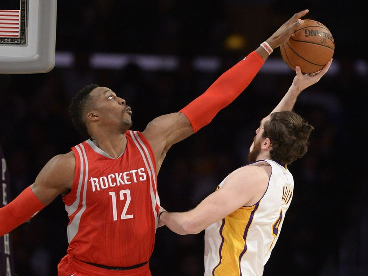 Jan. 17, 2016: Rockets center Dwight Howard (12) stifles Lakers forward Ryan Kelly (4) for one of his three blocks on the night in Los Angeles. Howard added 14 points and 15 rebound to help Houston roll to a 112-95 win.  Richard Mackson, USA TODAY Sports