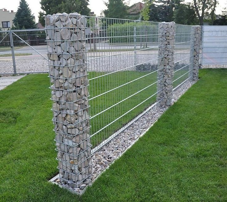 www.pinterest.com/1895gunner/ | Nice work - rock and metal fence