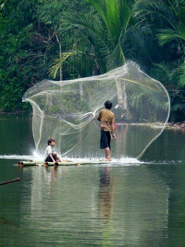 A Kanekes fisherman and his son