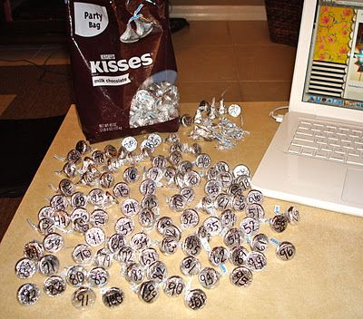 Hide 100 kisses in the classroom for the kids to find. On the bottom of each kiss, I write a number from 1 - 100. After the assigned number of kisses have been found by each kid, I'll call them up one at a time and let them add their numbered kisses to the hundred's chart.