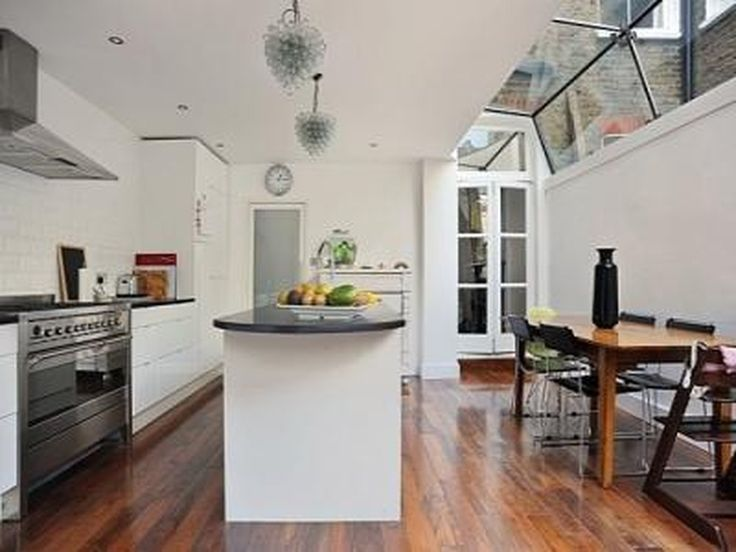 Kitchen Rear Extension - add light with roofed windows and french doors from living room. Love the roofed glass style here and doors from living room, this is what we are looking to do.