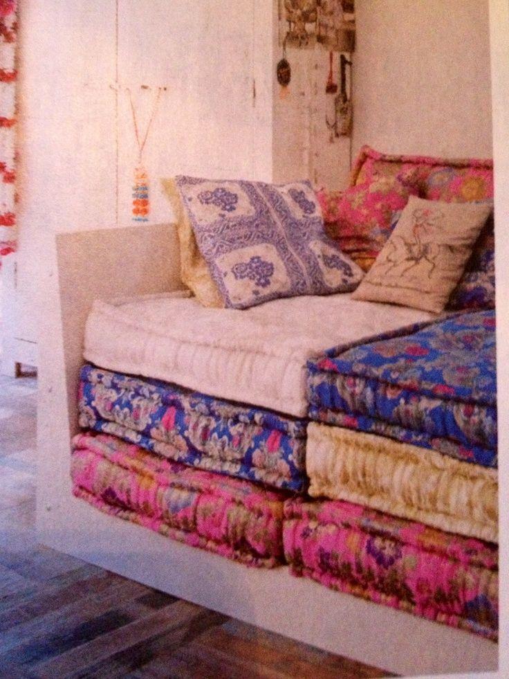 Sofa, stacks of floor cushions.