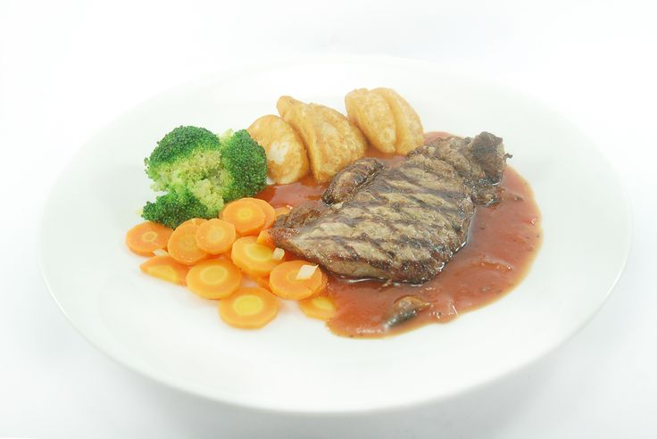 Grilled sirloin served with potato wedges, vichy carrot & broccoli, in a tasty Italian pizzaiola sauce