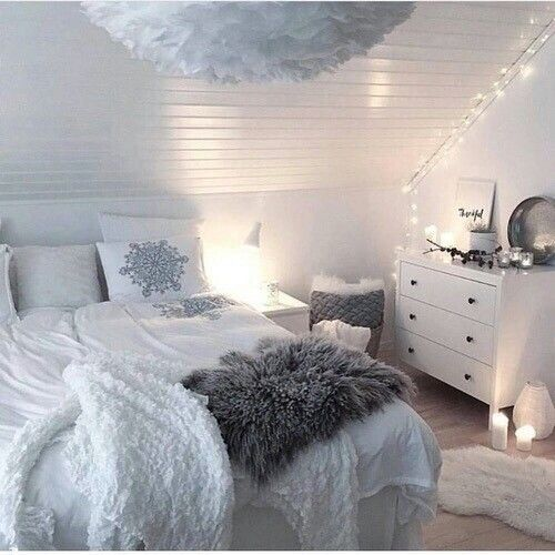 White and Grey Bedroom | White Bedding | Grey Accents | White Walls | Slanted Ceiling