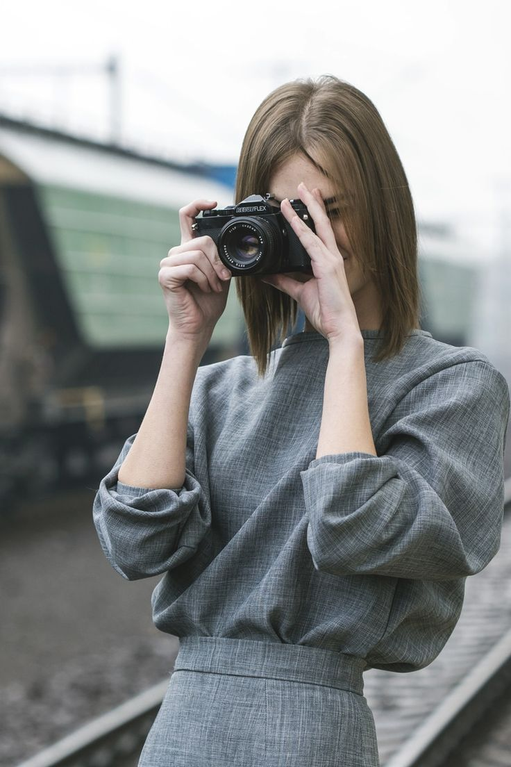 Brown Haired Woman in Gray 3/4 Sleeved Dress Holding a Camera